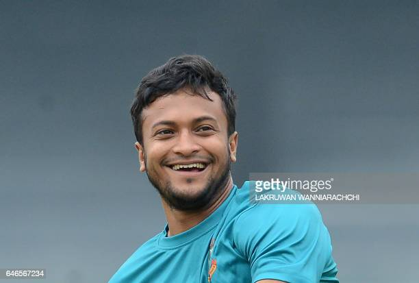 Bangladesh cricketer Shakib Al Hasan shares a light moment with teammates during a practice session at the R Premadasa Stadium in Colombo on March 1...