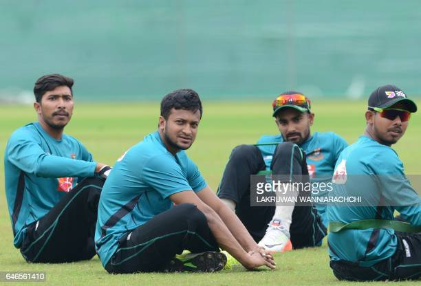 Bangladesh cricketer Shakib Al Hasan takes a rest with teammates during a practice session at the R Premadasa Stadium in Colombo on March 1 2017...