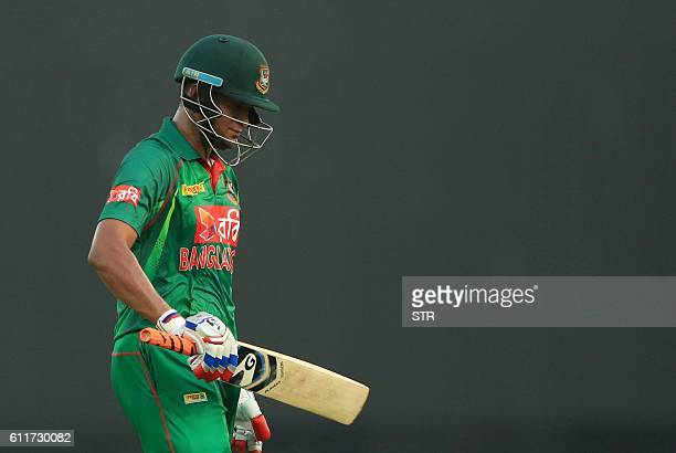 Bangladesh cricketer Shakib Al Hasan walks back to the pavilion after his dismissal during the third one day international cricket match between...