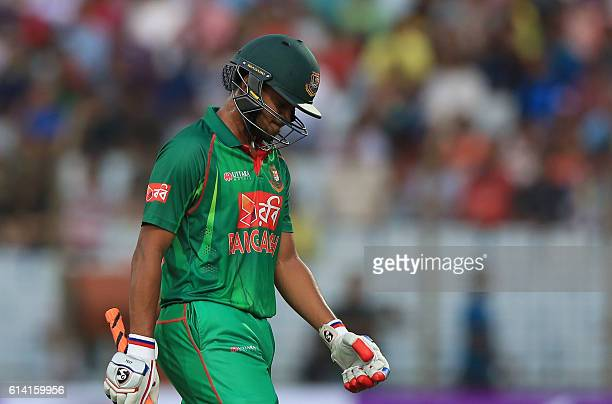 Bangladesh cricketer Shakib Al Hasan walks back to the pavilion after his dismissal during the third and final One Day International cricket match...