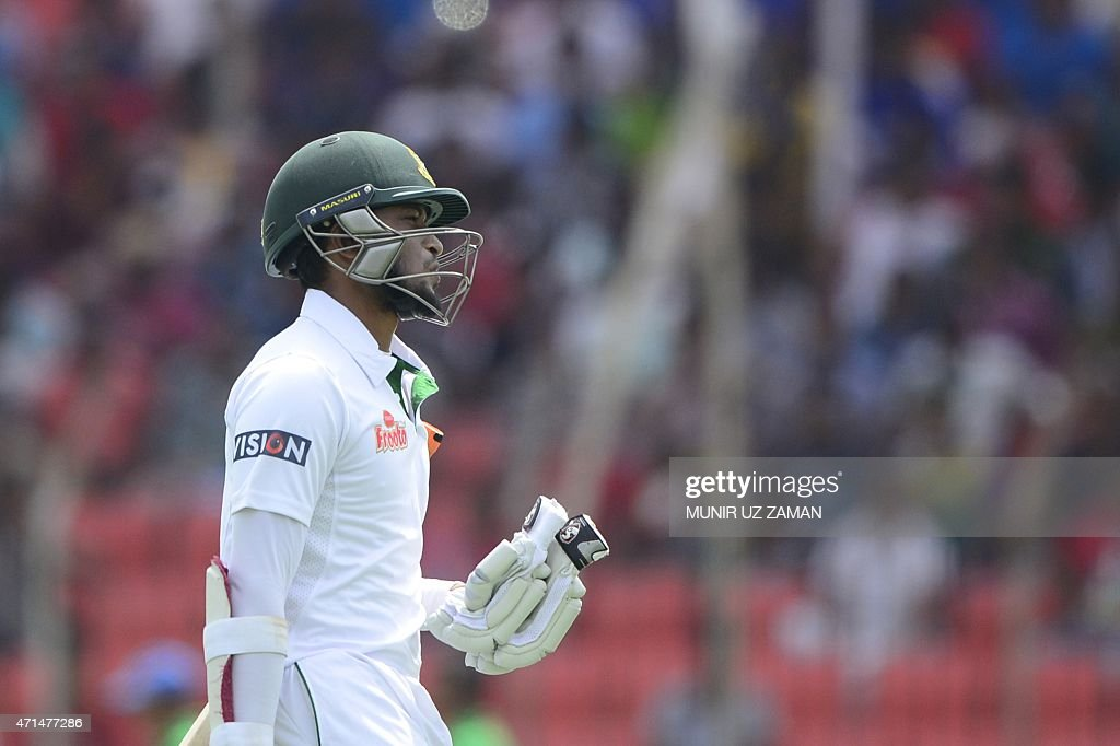 Bangladesh cricketer Shakib Al Hasan walks off the field after his dismissal during the second day of the first cricket Test match between Bangladesh...