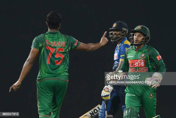 Bangladesh cricketer Shakib alHasan celebrates with his teammates after he dismissed Sri Lankan cricketer Thisara Perera during the second T20...