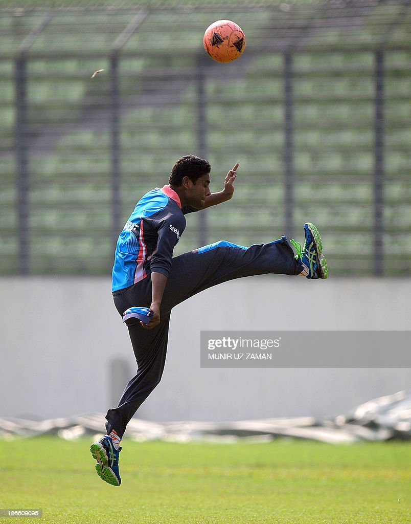 Bangladesh cricketer Sohag Gazi plays with a football during a training session at the Sher-e Bangla National Stadium in Dhaka on November 2, 2013, in preparation for the third One Day International (ODI) cricket match against New Zealand to be played on November 3. AFP PHOTO/ Munir uz ZAMAN