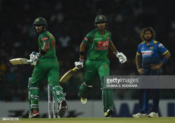 Bangladesh cricketer Soumya Sarkar and Sabbir Rahman run between the wickets during the first T20 international cricket match between Sri Lanka and...