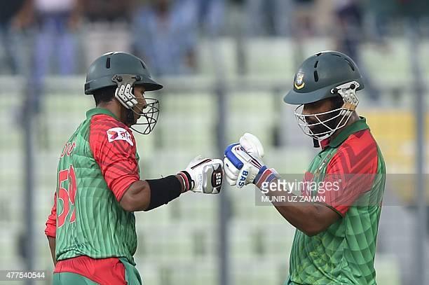 Bangladesh cricketer Soumya Sarkar celebrates his half century with teammate Tamim Iqbal during the first one day international cricket match between...