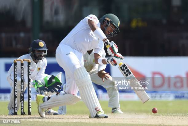 Bangladesh cricketer Soumya Sarkar plays a shot as Sri Lankan wicketkeeper Niroshan Dickwella looks on during the second day of the second and final...