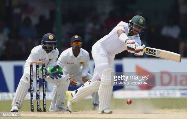 Bangladesh cricketer Soumya Sarkar plays a shot as Sri Lankan wicketkeeper Niroshan Dickwella looks during the fifth and final day of the second and...