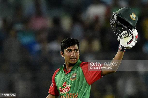 Bangladesh cricketer Soumya Sarkar reacts after scoring a century during the third One Day International cricket match between Bangladesh and...