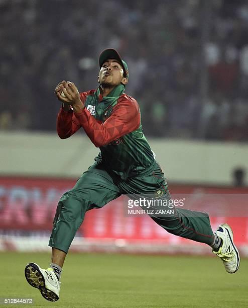 Bangladesh cricketer Soumya Sarkar takes a catch to dismiss Sri Lanka cricketer Tillakaratne Dilshan during the match between Bangladesh and Sri...