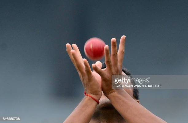 TOPSHOT Bangladesh cricketer Subashis Roy catches a ball during a practice session at the R Premadasa Stadium in Colombo on March 1 2017 ahead of a...
