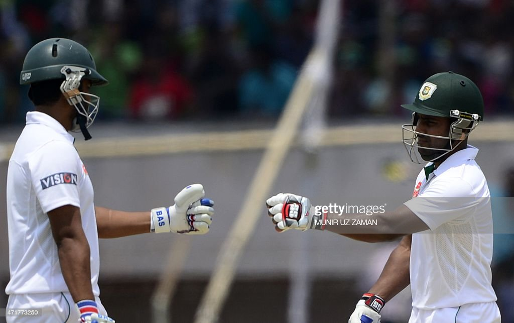 Bangladesh cricketer <a gi-track='captionPersonalityLinkClicked' href=/galleries/search?phrase=Tamim+Iqbal&family=editorial&specificpeople=4181226 ng-click='$event.stopPropagation()'>Tamim Iqbal</a> (L) celebrates with teammate <a gi-track='captionPersonalityLinkClicked' href=/galleries/search?phrase=Imrul+Kayes&family=editorial&specificpeople=5565752 ng-click='$event.stopPropagation()'>Imrul Kayes</a> (R) after hitting a boundary during the fourth day of the first cricket Test match between Bangladesh and Pakistan at The Sheikh Abu Naser Stadium in Khulna on May 1, 2015. AFP PHOTO/Munir uz ZAMAN