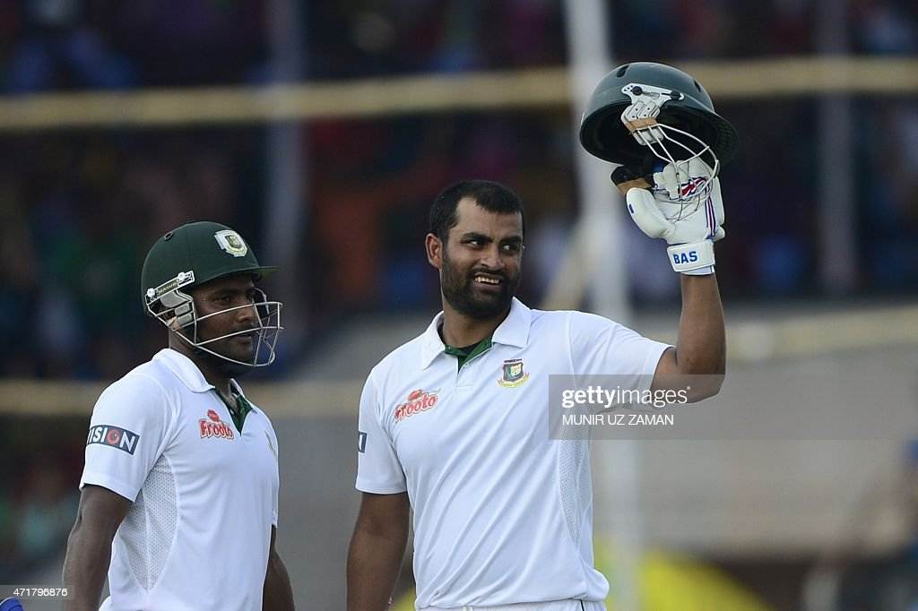 Bangladesh cricketer <a gi-track='captionPersonalityLinkClicked' href=/galleries/search?phrase=Tamim+Iqbal&family=editorial&specificpeople=4181226 ng-click='$event.stopPropagation()'>Tamim Iqbal</a> (R) reacts after scoring a century (100 runs) as teammate <a gi-track='captionPersonalityLinkClicked' href=/galleries/search?phrase=Imrul+Kayes&family=editorial&specificpeople=5565752 ng-click='$event.stopPropagation()'>Imrul Kayes</a> (L) looks on during the fourth day of the first cricket Test match between Bangladesh and Pakistan at The Sheikh Abu Naser Stadium in Khulna on May 1, 2015. AFP PHOTO/Munir uz ZAMAN