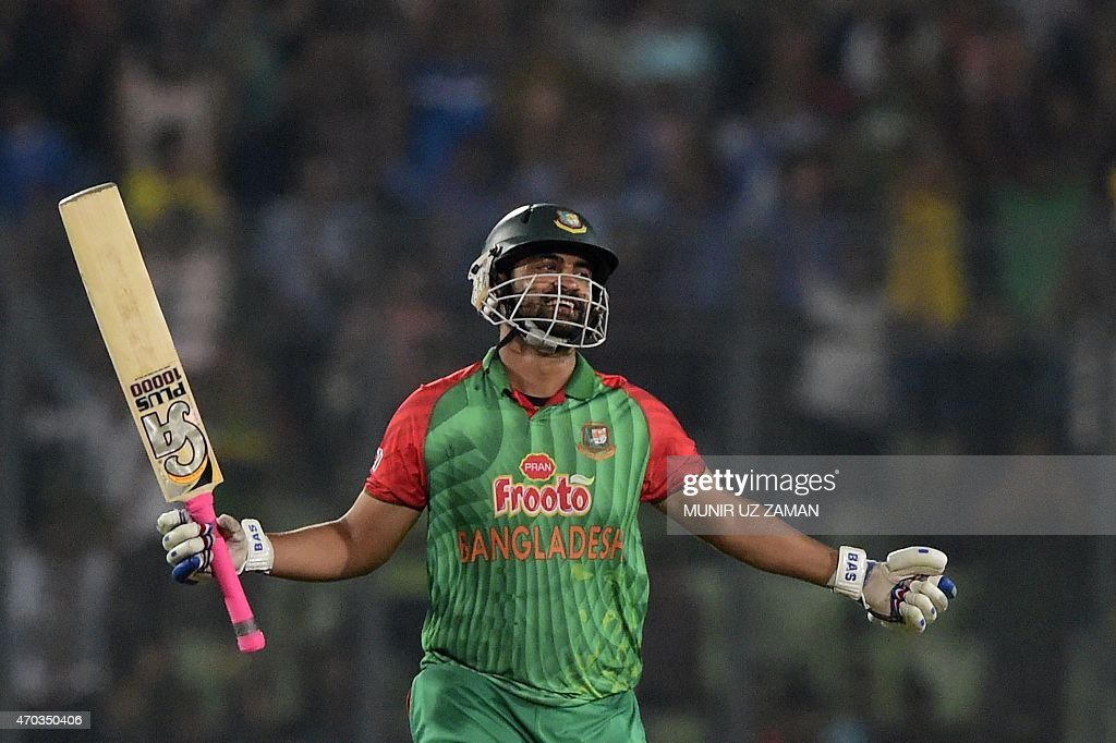 Bangladesh cricketer <a gi-track='captionPersonalityLinkClicked' href=/galleries/search?phrase=Tamim+Iqbal&family=editorial&specificpeople=4181226 ng-click='$event.stopPropagation()'>Tamim Iqbal</a> reacts after scoring a century (100 runs) during the second One Day International cricket match between Bangladesh and Pakistan at the Sher-e-Bangla National Cricket Stadium in Dhaka on April 19, 2015. AFP PHOTO/ Munir uz ZAMAN