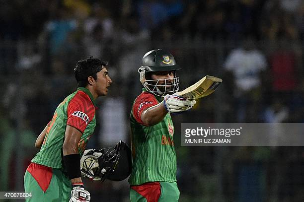 Bangladesh cricketer Tamim Iqbal reacts after scoring a half century as his teammate Soumya Sarkar looks on during the third One Day International...
