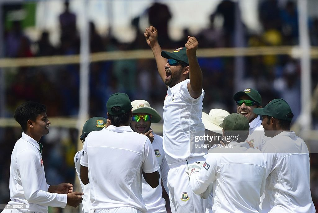 Bangladesh cricketer Tamim Iqbal reacts after the dismissal of unseen Pakistan batsman Sami Aslam during the second day of the first cricket Test...