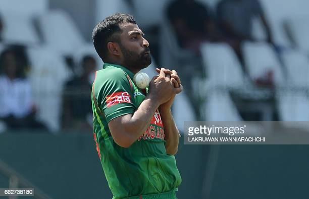 Bangladesh cricketer Tamim Iqbal takes a catch to dismiss Sri Lankan batsman Dilruwan Perera during the third and final one day international cricket...