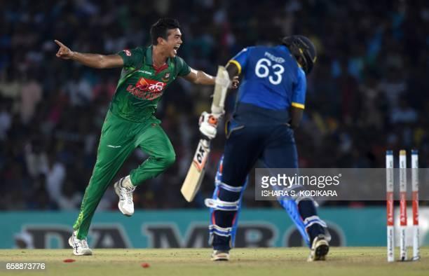 Bangladesh cricketer Taskin Ahmed celebrates after dismiss Sri Lankan cricketer Nuwan Pradeep during the second one day international cricket match...