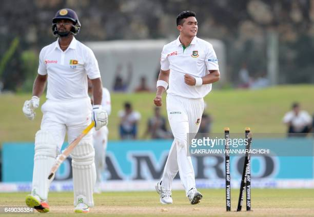 Bangladesh cricketer Taskin Ahmed celebrates after he dismissed Sri Lankan cricketer Asela Gunaratne during the first day of the opening Test cricket...