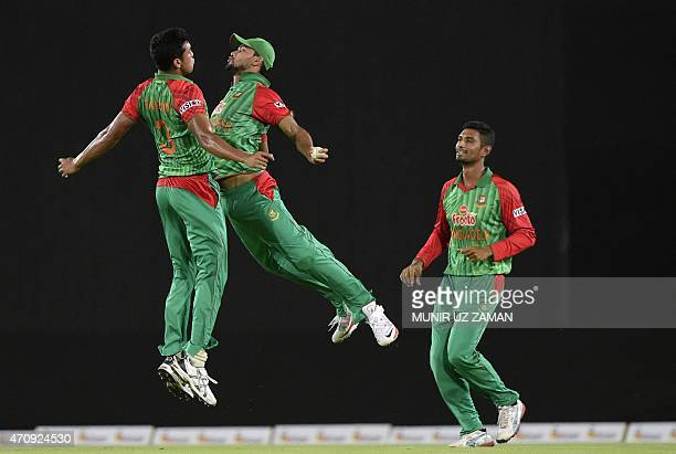 Bangladesh cricketer Taskin Ahmed celebrates with captain Mashrafe Bin Mortaza as Mohammad Mahmudullah looks onafter the dismissal of Pakistan...