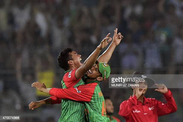 Bangladesh cricketer Taskin Ahmed celebrates with teammate Nasir Hossain after the dsimissal of Pakistan cricketer Haris Sohail during the first One...