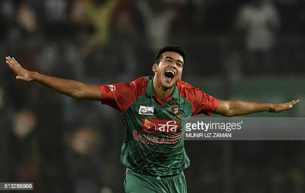Bangladesh cricketer Taskin Ahmed reacts after the dismissal of Pakistan batsman Umar Akmal during the Asia Cup T20 cricket tournament match between...