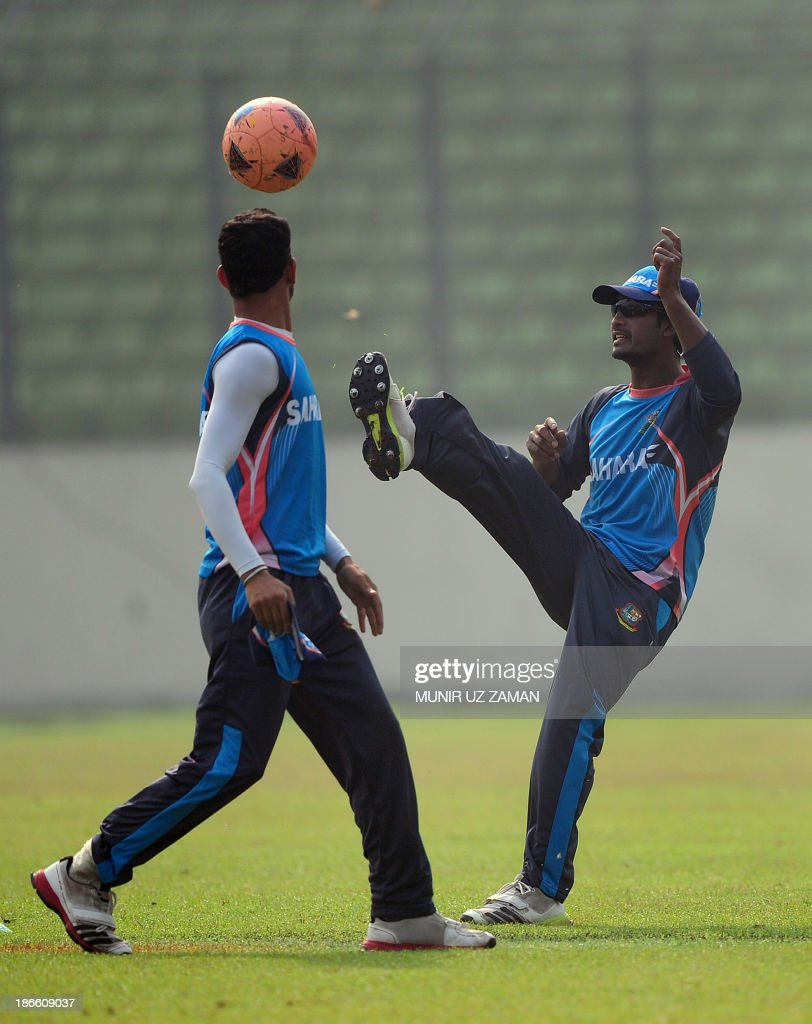 Bangladesh cricketerers Naeem Islam (R) and Nasir Hossain play football during a training session at the Sher-e Bangla National Stadium in Dhaka on November 2, 2013, in preparation for the third One Day International (ODI) cricket match against New Zealand to be played on November 3. AFP PHOTO/ Munir uz ZAMAN