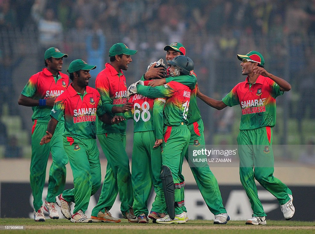 Bangladesh cricketers celebrate after the dismissal of the unseen West Indies batsman Kieron Pollard during the fifth one day international between Bangladesh and West Indies at The Sher-e-Bangla National Cricket Stadium in Dhaka on December 8, 2012. AFP PHOTO/ Munir uz ZAMAN