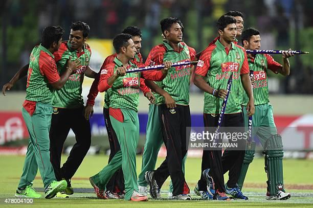 Bangladesh cricketers celebrate after winning the second ODI cricket match between Bangladesh and India at the ShereBangla National Cricket Stadium...