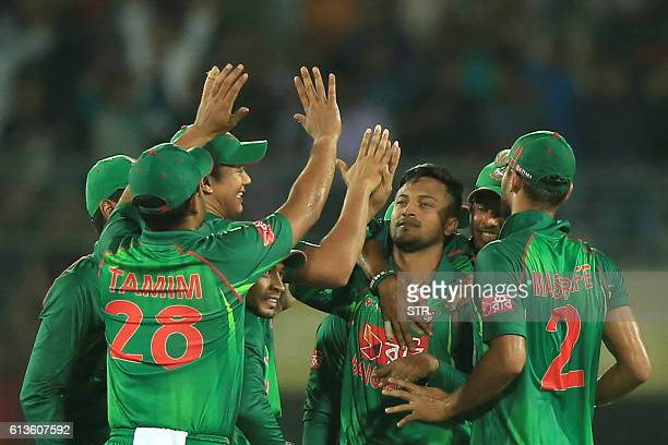 Bangladesh cricketers congratulate Shakib Al Hasan after the dismissal of the England cricketer Ben Duckett during the second one day international...