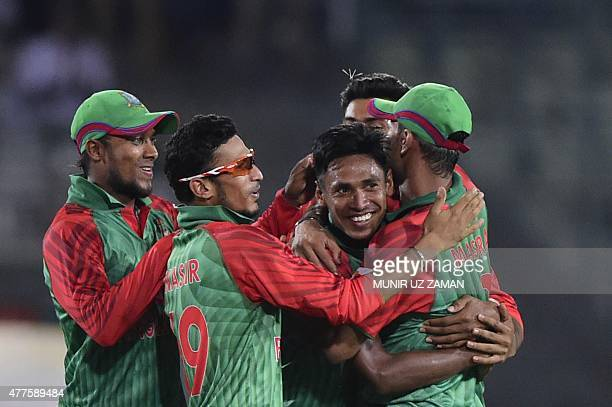 Bangladesh cricketers congratulate teammate Mustafizur Rahman after the dismissal of Indian cricketer Rohit Sharma during the first One Day...