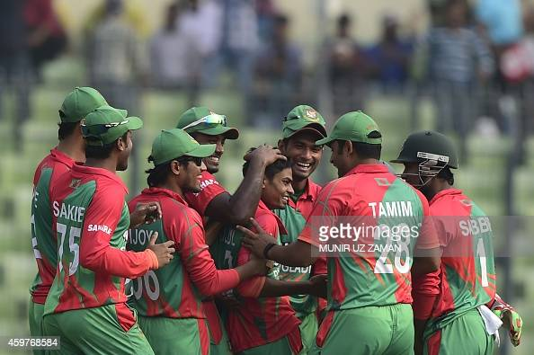 Bangladesh cricketers congratulate teammate Taijul Islam after his hattrick during the fifth and the final oneday international match between...