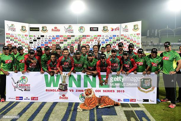 Bangladesh cricketers pose for a photograph following the presentation ceremony after the third oneday international cricket match between Bangladesh...