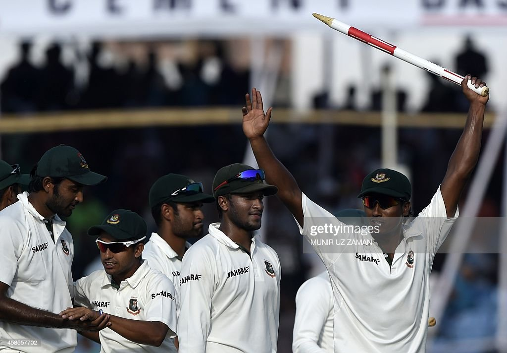 Bangladesh cricketers Rubel Hossain acknowledges the crowd as Shakib Al Hasan looks on as they walk off the field after winning the second cricket...