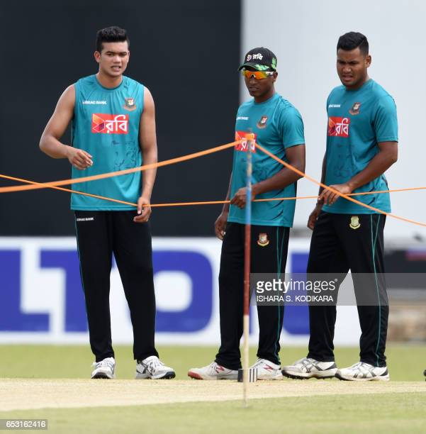 Bangladesh cricketers Subashis Roy Rubel Hossain and Taskin Ahmed inspect the pitch during a practice session at the P Sara Oval Cricket Stadium in...