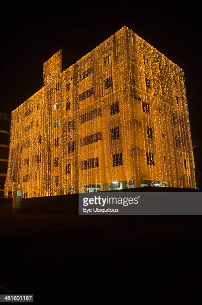 Bangladesh Dhaka Gulshan Apartment block at night lit up for a wedding with strings of fairy lights cascading over the side