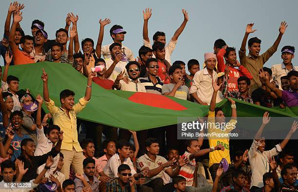 Bangladesh fans cheer with a large flag during the third day of the second test match between Bangladesh and England at Shere Bangla National Stadium...