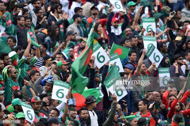 Bangladesh fans wave banners during the ICC Champions Trophy match between Australia and Bangladesh at The Oval in London on June 5 2017 / AFP PHOTO...