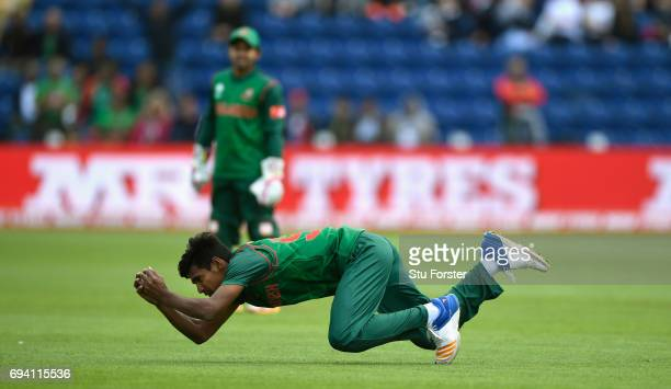 Bangladesh fielder Mustafizur Rahman swoops to catch Ross Taylor during the ICC Champions Trophy match between New Zealand and Bangladesh at SWALEC...
