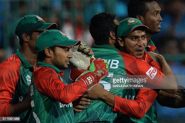 Bangladesh fielder Soumya Sarkar celebrates with teammates after taking a catch to dismiss Indian batsman Hardik Pandya during the World T20 cricket...