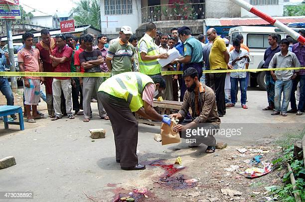 Bangladesh forensics police investigate the site where blogger Ananta Bijoy Das was hacked to death in Sylhet on May 12 2015 A masked gang wielding...