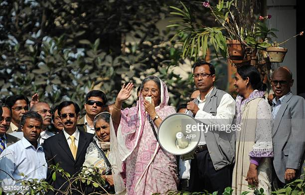 Bangladesh former prime minister and Awami League leader Sheikh Hasina Wajed gestures as she addresses supporters at her residence in Dhaka on...