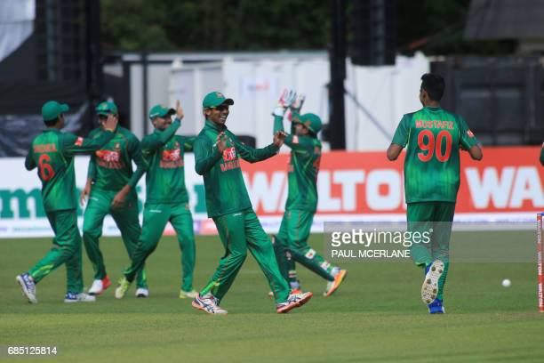 Bangladesh Mustafizur Rahman celebrates with teammates during the fourth ODI match of the Ireland TriNation Series between Ireland and Bangladesh at...
