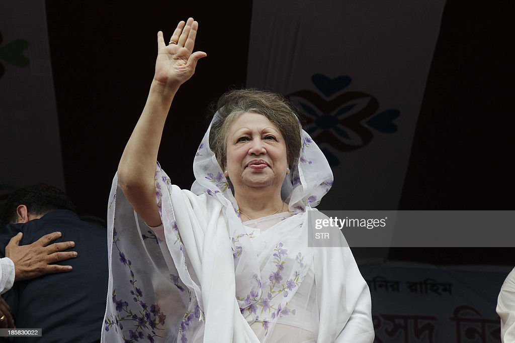 Bangladesh Nationalist Party (BNP) chairperson, opposition leader, and two time former-prime minister, Khaleda Zia, waves at a rally organized by the BNP-led 18-Party alliance in Dhaka on October 25, 2013. Three demonstrators were killed across Bangladesh and more than 100,000 opposition activists rallied in the capital Dhaka to demand that Prime Minister Sheikh Hasina quit and order polls under a caretaker government.