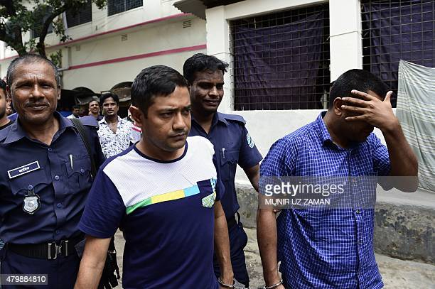 Bangladesh owner of the collapsed Rana Plaza building Sohel Rana is escorted by security personnel ahead of his appearance at a court in Dhaka on...