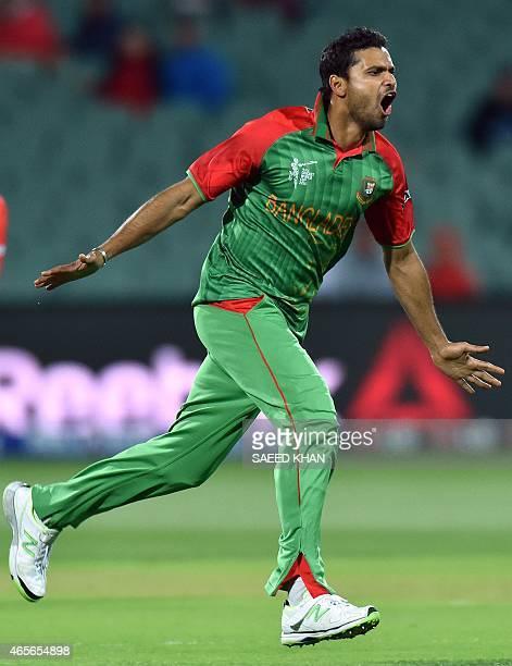Bangladesh paceman Mashrafe Mortaza celebrates his wicket of England's batsman Joe Root during the 2015 Cricket World Cup Pool A match between...
