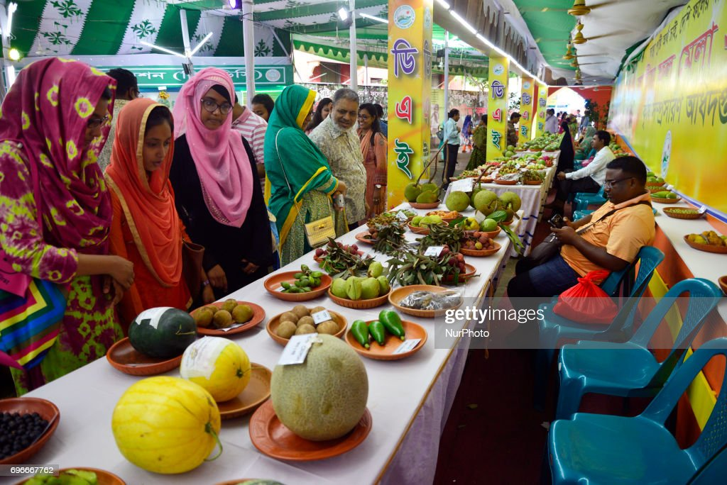 Bangladesh peoples visits the National Fruit exhibition at Agricultural Institute in Dhaka, Bangladesh, on June 16, 2017. Bangladesh Agriculture Minister organized a National Fruit exhibition from June 16 to June 18 at Agricultural Institute in Dhaka. Many Government and Privet organization participants with National and International fruits the National Fruit exhibition in Bangladesh.