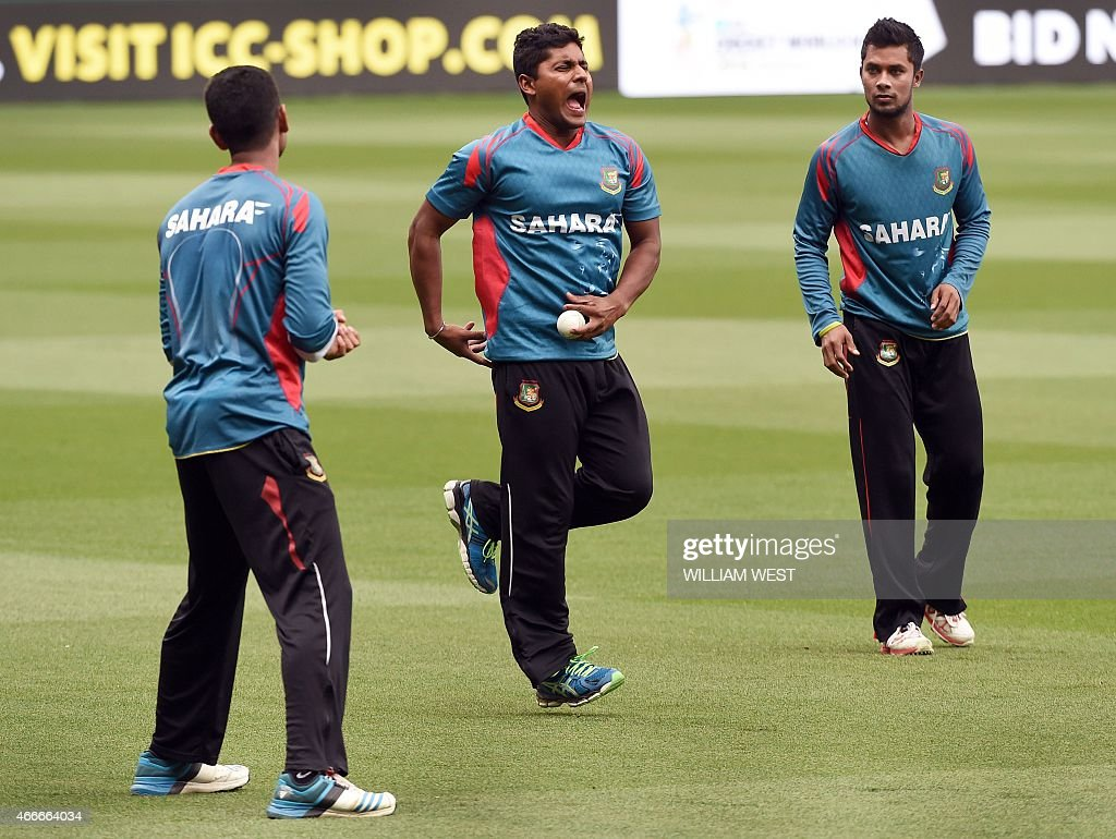 Bangladesh player <a gi-track='captionPersonalityLinkClicked' href=/galleries/search?phrase=Imrul+Kayes&family=editorial&specificpeople=5565752 ng-click='$event.stopPropagation()'>Imrul Kayes</a> (C) reacts after taking a catch during a training session ahead of their 2015 Cricket World Cup quarter-final match against India, in Melbourne on March 18, 2015. AFP PHOTO / William WEST --IMAGE