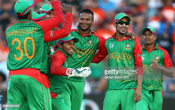 Bangladesh players celebrate a wicket during the 2015 ICC Cricket World Cup match between Bangladesh and New Zealand at Seddon Park on March 13 2015...
