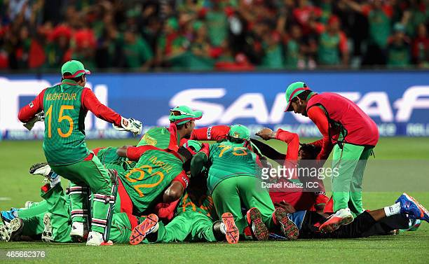 Bangladesh players celebrate after defeating England during the 2015 ICC Cricket World Cup match between England and Bangladesh at Adelaide Oval on...