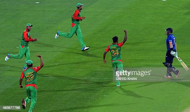 Bangladesh players celebrate the dismissal of England batsman Ian Bell during their 2015 Cricket World Cup Pool A match at the Adelaide Oval on March...